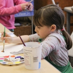 A student paints during Open Art Studio.