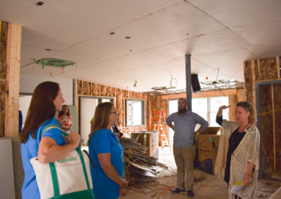 Staff touring the nearly-complete Emerson Village